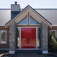 Bright red double axis entrance door